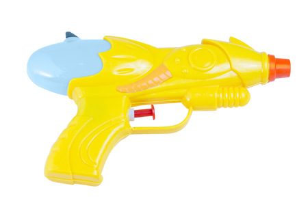 Image of a yellow waterpistol background isolated. photo