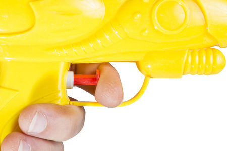 watergun: Close-up picture of a watergun with human hand