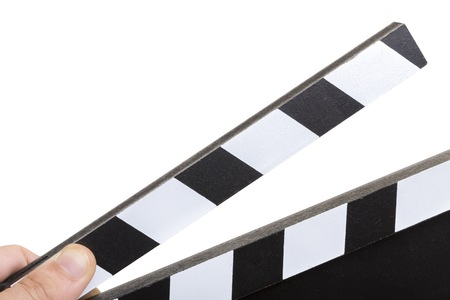Close up picture of a clapperboard with white background Banco de Imagens