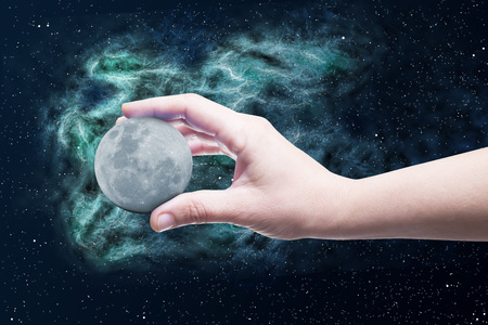 The moon in one and whith space background  photo