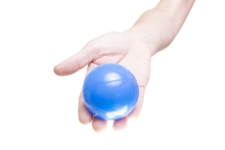 Human hand holding a blue ball, white background  photo