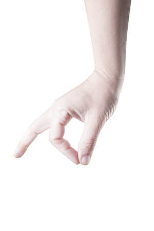 Picture of a human hand making a picking gesture. photo