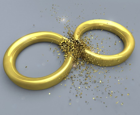 splitting up: Illustration of a symbol for the end of a marriage: two golden rings exploding. Stock Photo
