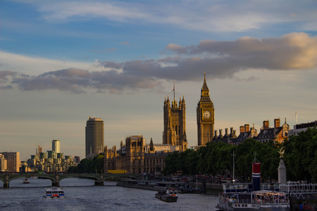 Big Ben, Houses of Parliament, and Westminster Bridge on the Thames at Sunset Stock Photo