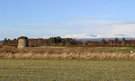 Culloden Moor with Winter Mountains and Cairn