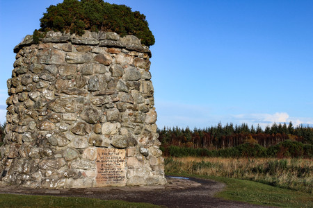 Giant cairn or grave marker at Culloden Moor, Scotland during a crisp autumn day. Stock Photo