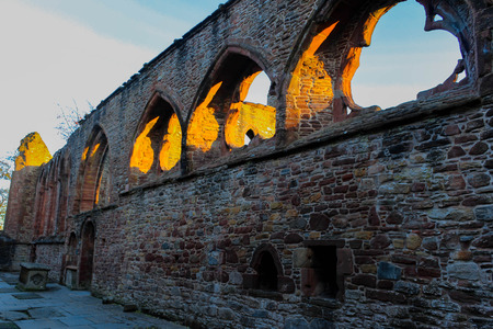 Sunset glow through the ruins of Beauly Priory In Scotland.