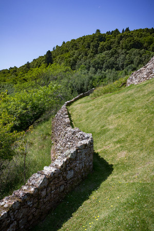 Old and crumbling retaining wall near Urquhart Castle in the Scottish Highlands.