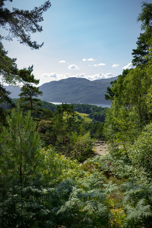The trail to the Falls of Foyers with a small bit of Loch Ness Peaking out in the Scottish Highlands. Stock Photo