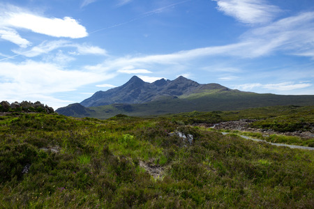 Trail and peak at Tir Nan Iolaire or Land of Eagles and the Cuillin on the Isle of Skye in Scotland. Stock Photo