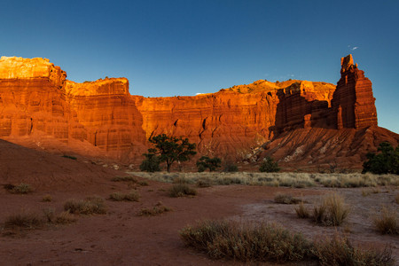 Alpenglow on gorgeous Chimney Rock in Capitol Reef National Park in Utah.