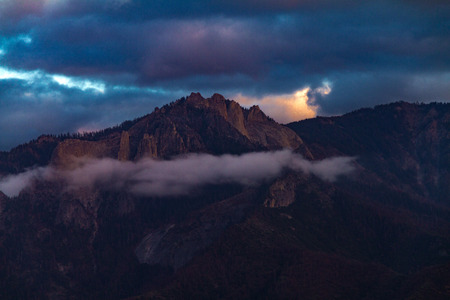 Epic magnificent sunset view of Castle Rock in Sequoia and Kings Canyon National Park after a storm.