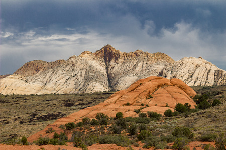 Amazing stormy view of the different sandstone colors in Snow Canyon State Park in Southern Utah.