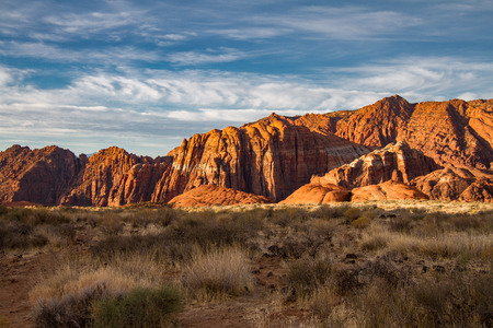 Spectacular sunrise illumination of the Navajo Sandstone mountains of Snow Canyon State Park in Utah.