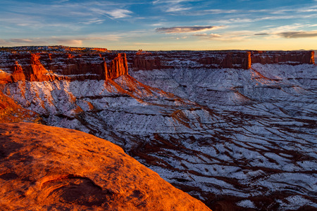 Gorgeous glowing red sunset on Canyonlands National Park with snow in Moab Utah USA.