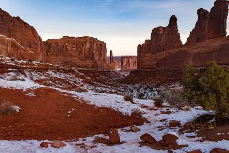 Beautiful snowy winters view of Park Avenue in Arches National Park in Moab, Utah USA.