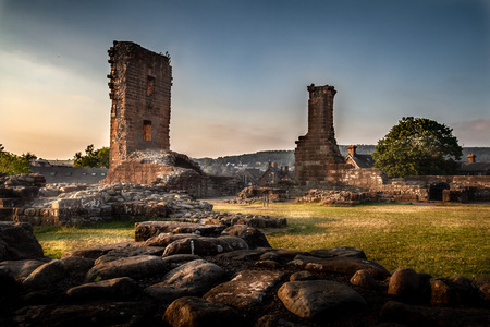 Incredible moody and artistic view of the Penrith Castle ruins at sunset in Cumbria, England UK.