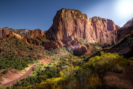 Spectacular Autumn view of Kolob Canyon, part of Zion National Park in Utah, and red road meandering up to the lookout point. Zdjęcie Seryjne
