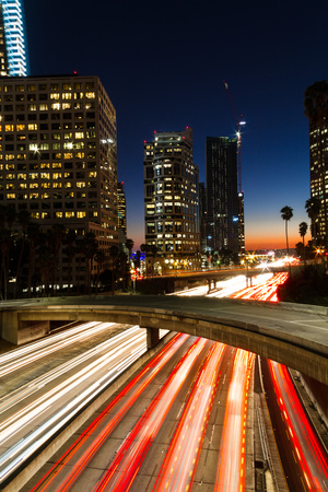 Amazing long exposure of Los Angeles Downtown traffic at night in California, USA. Zdjęcie Seryjne