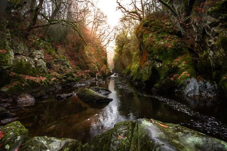 Spectacular sunset view of Fairy Glen at Betws-y-Coed in Snowdonia National Park, Wales in the autumn.