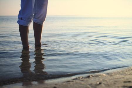 trouser legs: evening walk on the beach Stock Photo