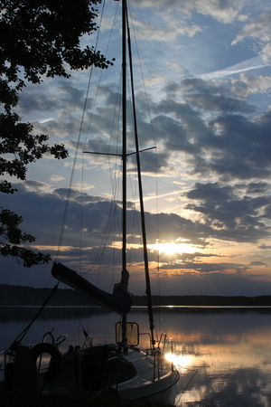 sailing boat in sunset Stock Photo