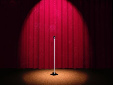 perform performance: A microphone on a stage with a spotlight on it.