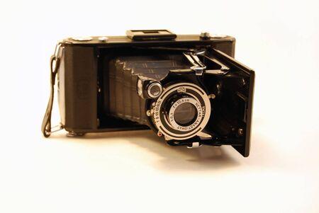 folding camera: A photo of an old folding camera.