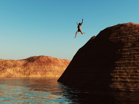 cliffs: A woman jumping from a cliff in to the water. Stock Photo