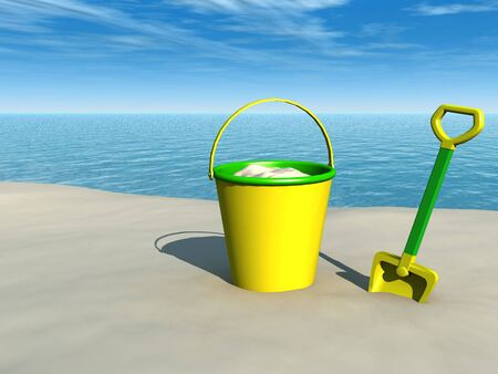 A bucket and a spade on a sandy beach with the ocean in the  background on a sunny day. photo