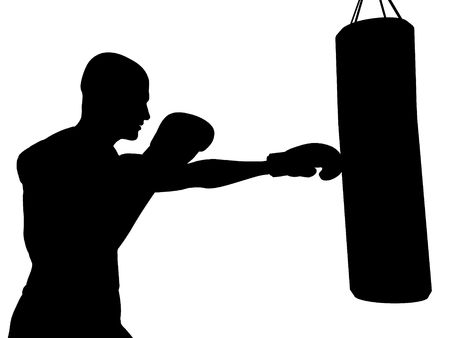 punching bag: A boxer exercising, ready to punch a punching bag.