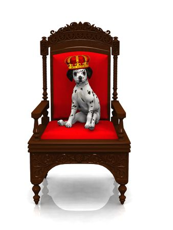 govern: A cute dalmatian puppy with a crown on his head sitting in a chair. Stock Photo