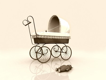 An old vintage pram with a teddybear on the floor beside it. Stock Photo
