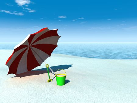 plaything: A sun parasol, bucket and spade on a beach by the sea on a sunny summer day.