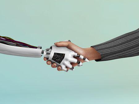 mano robotica: Una imagen del apret�n de manos entre un robot y un ser humano.