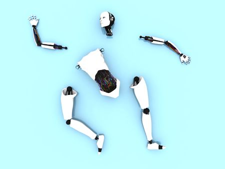 Body parts of a female robot lying spread out on the floor.