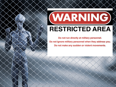 3D rendering of an alien creature standing trapped behind a chain link wire steel metal fence, looking at you. There is a big military warning sign hanging on the fence, maybe it's area 51.