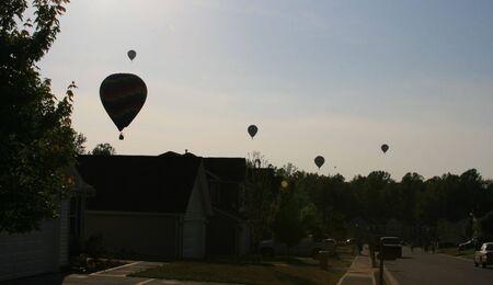 hot air balloons over neighborhood Stok Fotoğraf