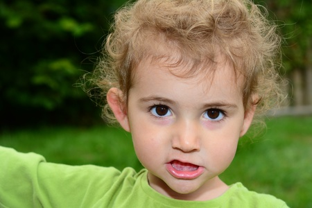 defiant: Young child staring at camera with a defiant expression Stock Photo