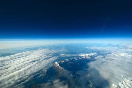 heaven on earth: Aerial view of clouds and blue sky over the earth Stock Photo