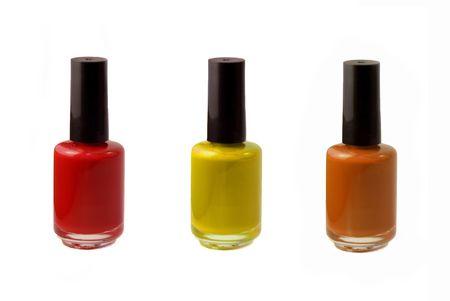 nail polish bottle: Colored photograph of three bottles of fingernail polish - red, orange, and yellow.  Stock Photo