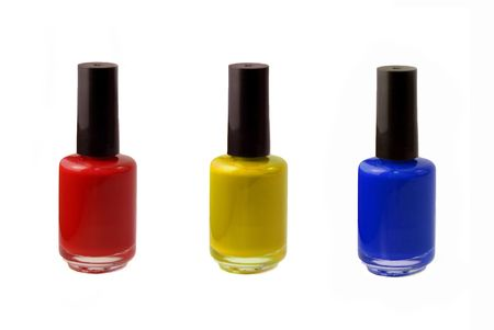 nail polish bottle: Colored photograph of three bottles of fingernail polish - red, blue, and yellow. Stock Photo