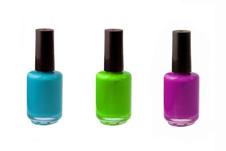 nail polish bottle: Colored photograph of three bottles of fingernail polish - neon blue, purple, and green. Picture taken with Sony Alpha 100. Stock Photo