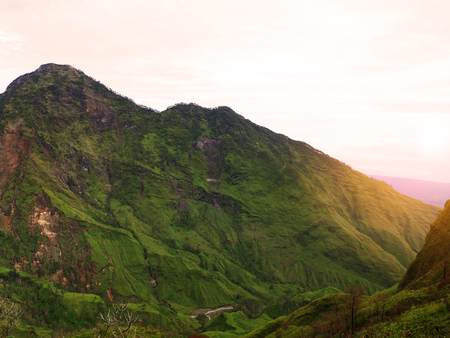 Beautiful green mountains in Rinjani, Lombok, Indonesia with flare lights