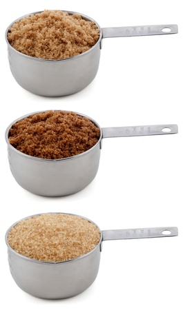 brown sugar: Different sugars - light brown soft or muscovado, dark brown soft or muscovado and demerera - in cup measures, isolated on a white background Stock Photo