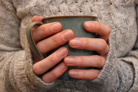 Closeup of a woman holding a mug