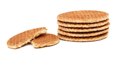 treacle: Stroopwafels, Dutch caramel waffles piled up, with one broken in half, isolated on a white background