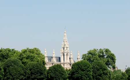 rise above: The spires of the Rathaus  City Hall  rise above the trees in Heldenplatz, Vienna