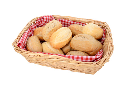 Basket of freshly baked bread rolls, isolated on a white background photo