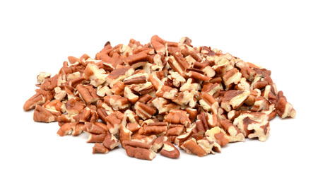 pecan: Chopped pecan nuts, isolated on a white